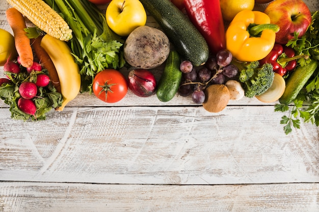 Elevated view of fresh vegetables on wooden plank
