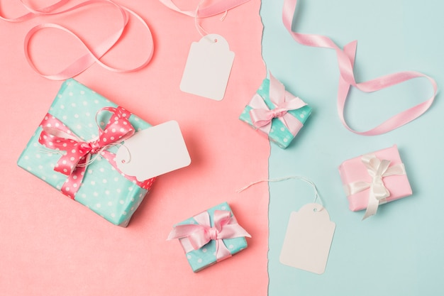 Elevated view of gifts; blank tags and ribbon