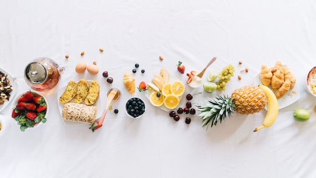 Elevated view of healthy breakfast on white background