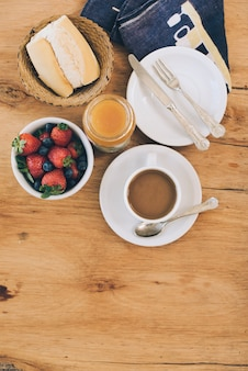 An elevated view of healthy breakfast with coffee on wooden table