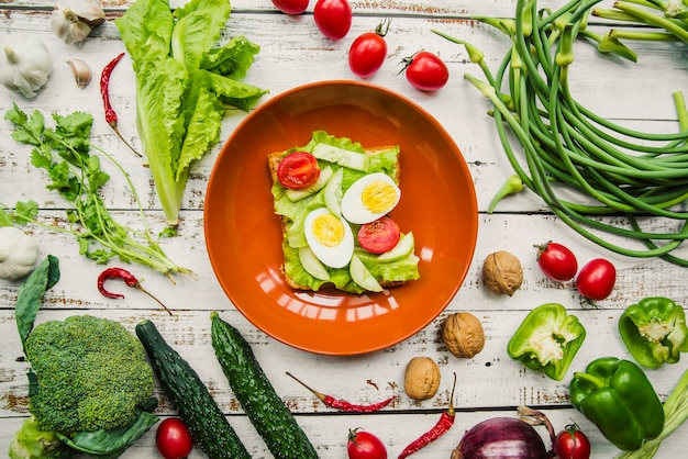 Elevated view of healthy egg and vegetables sandwich in bowl