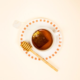 Elevated view of healthy tea with honey dipper