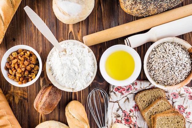 Elevated view of ingredients for making bread on wooden table