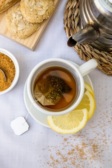 Elevated view of lemon tea and brown sugar on table