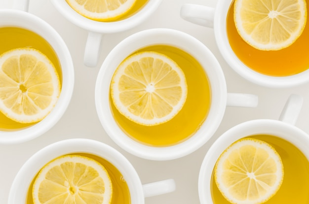An elevated view of lemon tea cup isolated on white background