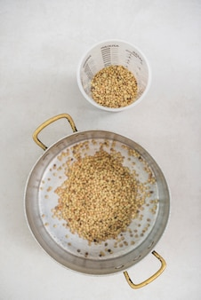 Elevated view of lentils on white background