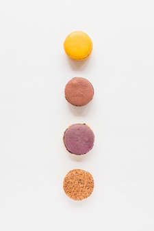 Elevated view of macaroons on white backdrop