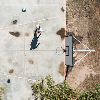 Elevated view of man playing with basketball