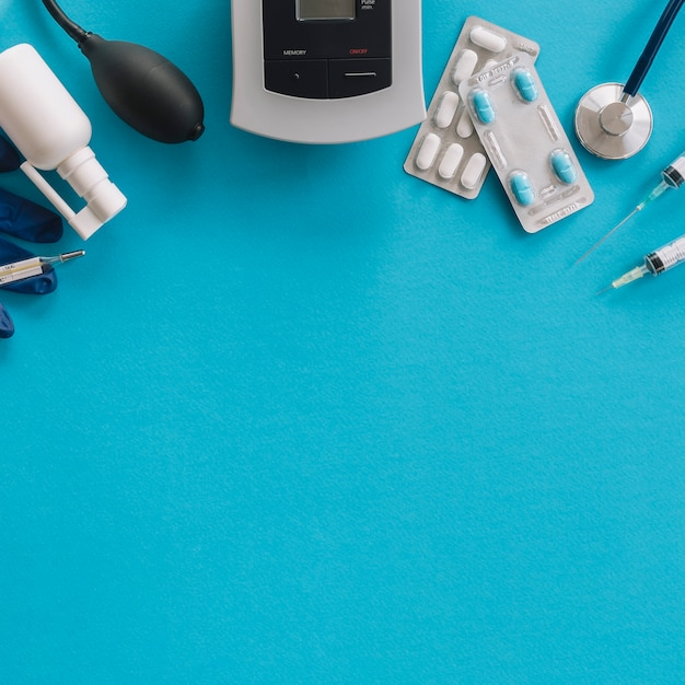 Elevated view of medical equipments on blue background
