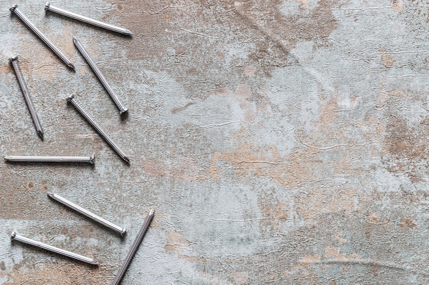Elevated view of nails on rusty wooden background
