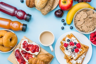Elevated view of breakfast on blue background