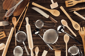 Elevated view of different kitchen utensils on wooden table