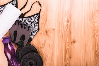 Elevated view of Fitness equipments on wooden floor