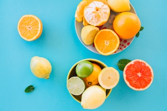 Elevated view of fresh juicy fruits on blue background