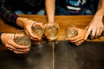 Elevated view of friends holding tequila glasses