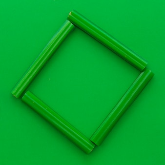 Elevated view of green licorice candies forming frame