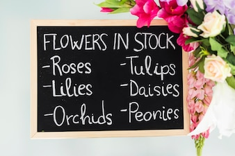 Elevated view of slate showing various flowers in stock