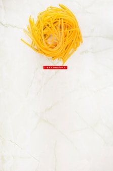 Elevated view of spaghetti on marble