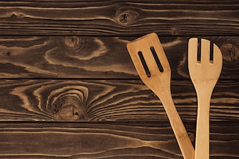 Elevated view of two different wooden spatulas on table