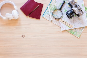 Elevated view of various traveler accessories on wooden surface