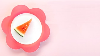 Elevated view of watermelon slice on floral shaped plate