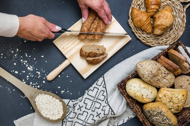 Elevated view of a person's hand slicing bread with knife
