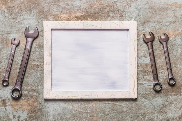 Elevated view of picture frame near combination wrench
