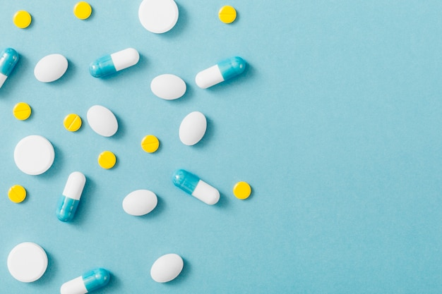 Elevated view of pills on blue background