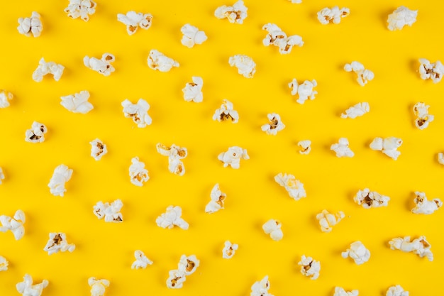 Elevated view of popcorn on yellow surface