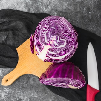 Elevated view of purple cabbage on wooden chopping board