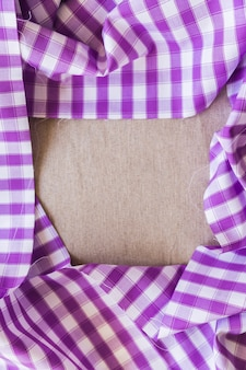 Elevated view of purple plaid table cloth forming frame
