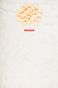 Elevated view of raw gnocchi pasta on marble