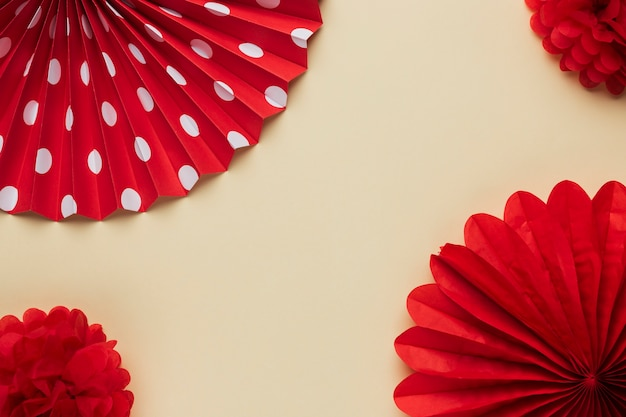 Elevated view of red beautiful origami flower pattern