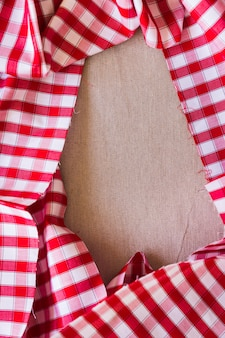 Elevated view of red plaid pattern fabric forming frame