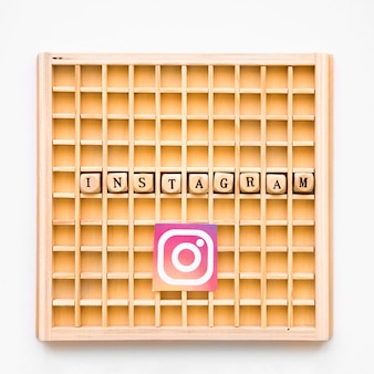 Elevated view of scrabble wooden game with instagram word and icon
