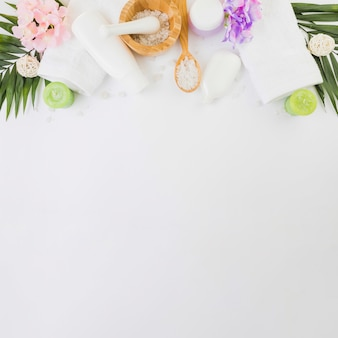 Elevated view of spa products on white background