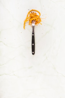 Elevated view of spaghetti pasta rolled on fork