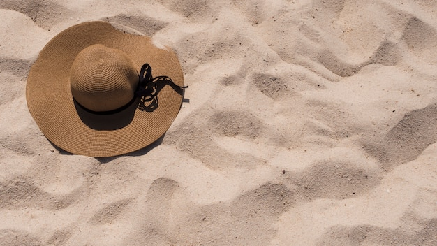 An elevated view of sunhat on beach sand