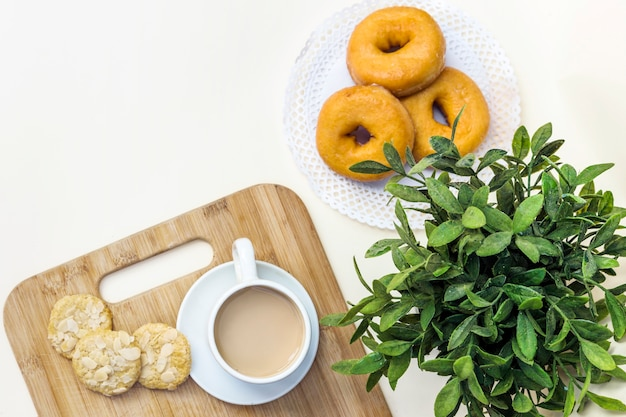 Elevated view of tea, cookies and donuts