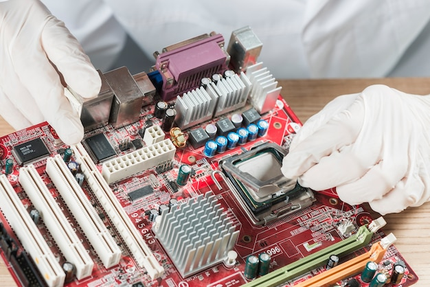 Elevated view of a technician working on computer motherboard