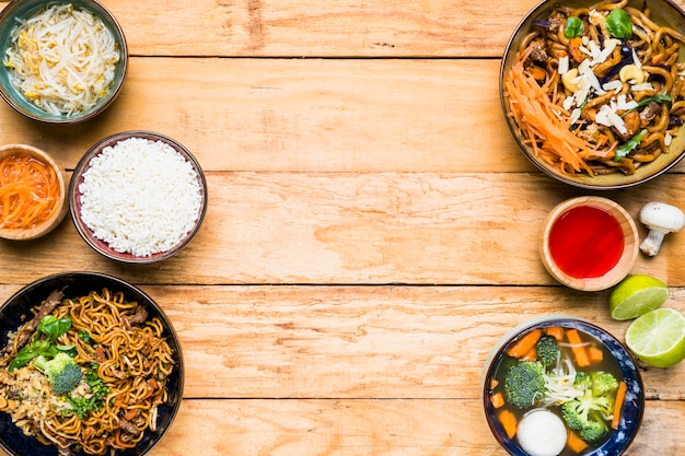 An elevated view of traditional thai food on wooden desk