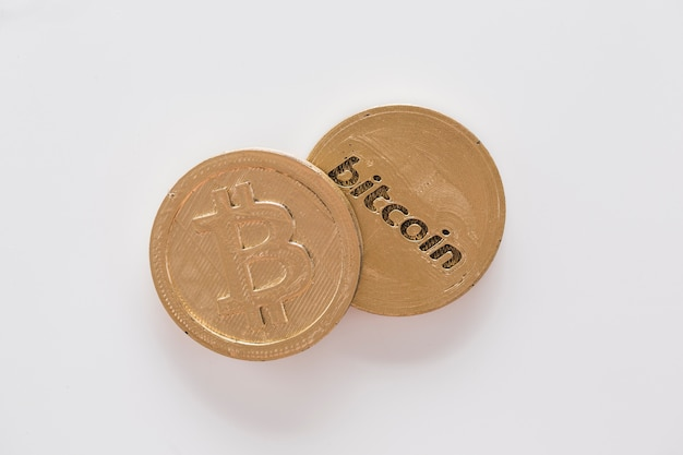 Elevated view of two bitcoins on white background