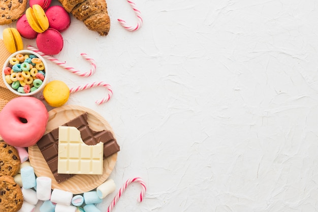 Elevated view of unhealthy food on white background