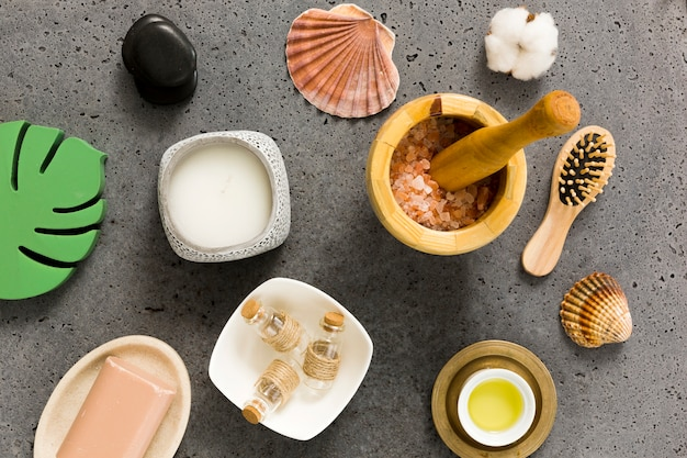 Elevated view of various beauty care products and sea shells