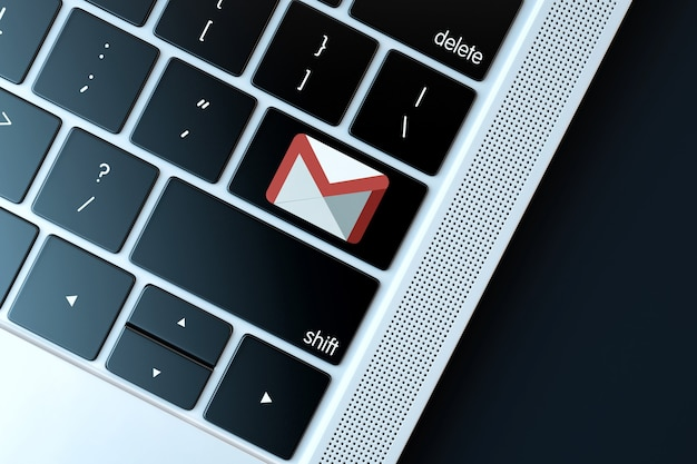 Email icon on laptop keyboard technology concept