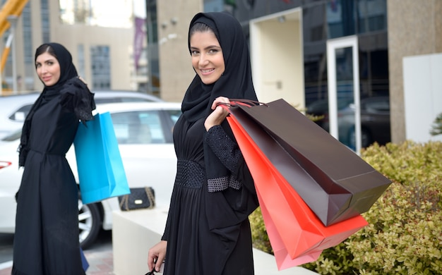 Emarati arab women coming out of shopping