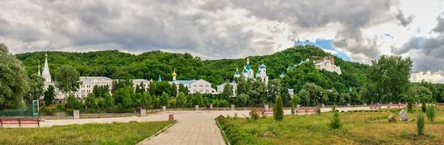 Embankment near the seversky donets river opposite the svyatogorsk lavra on a sunny summer morning