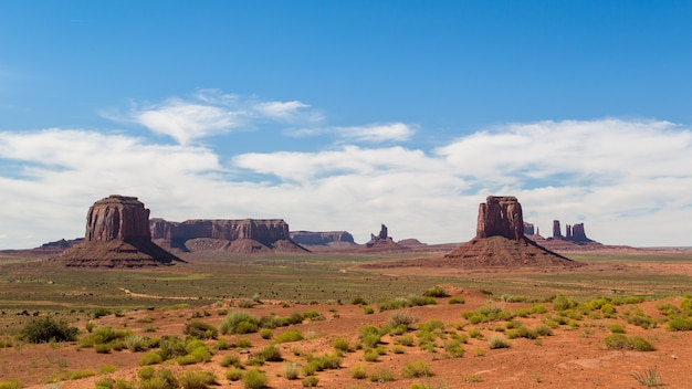 Emblematic place, which is the desert of monument valley with a fine red sand