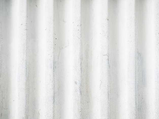 Embossed concrete background of white color vertical stripes