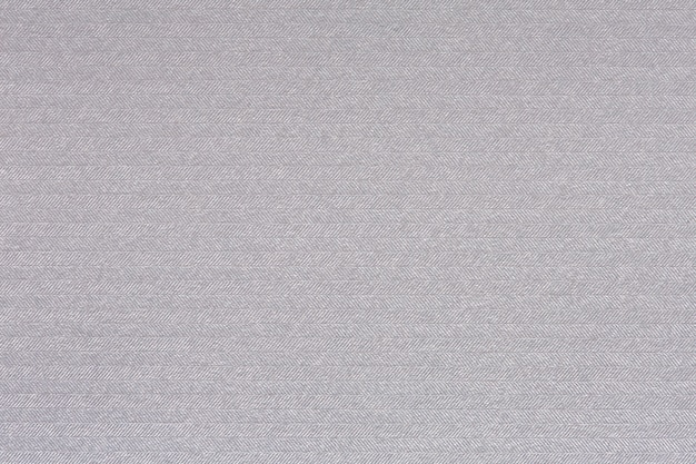 Embossed white paper with paralel lines pattern. high quality texture in extremely high resolution
